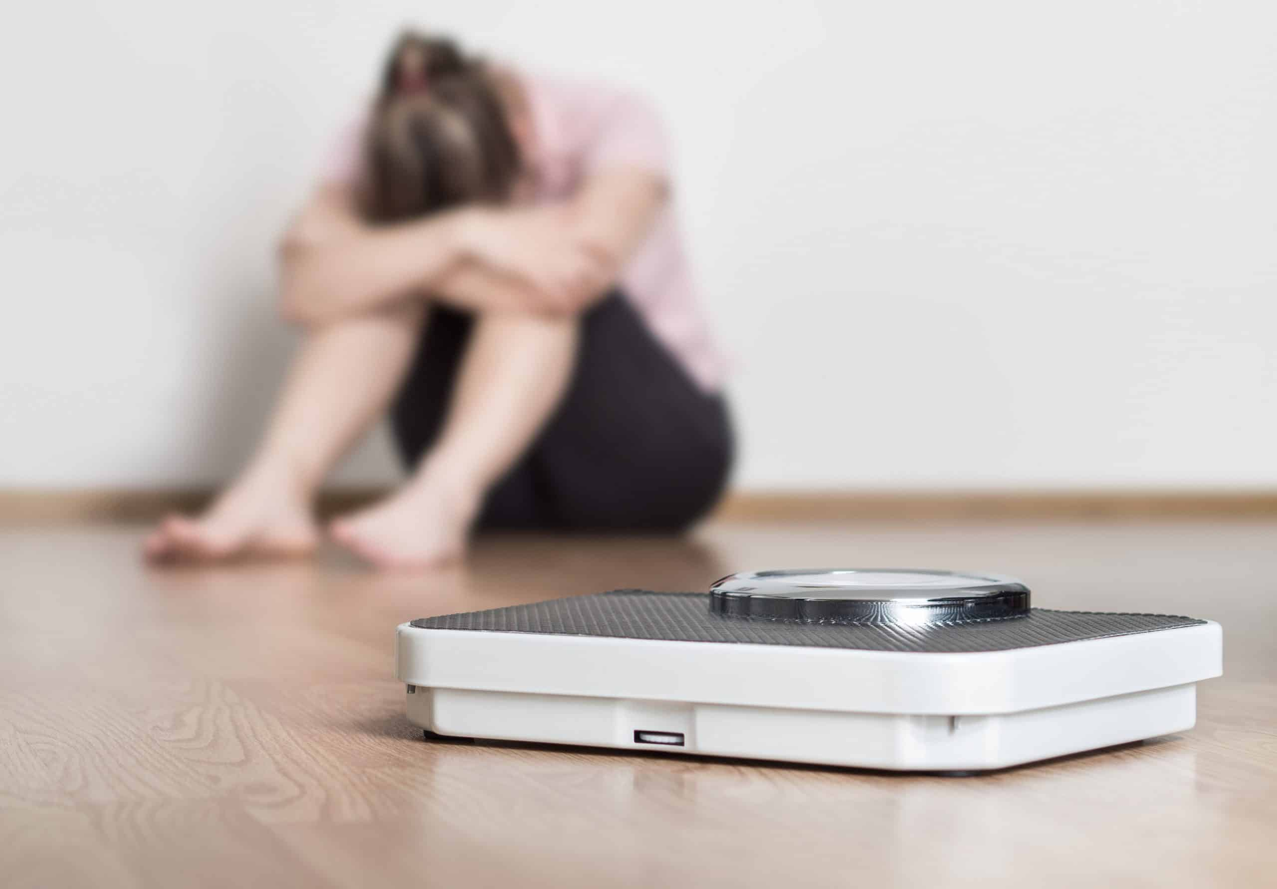Woman with an eating disorder who is afraid of the weighing herself